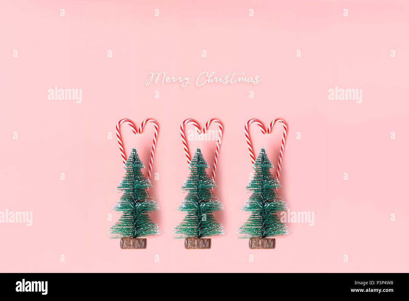 Tree Christmas Tree With Candy Cane Hanging On Pastel Pink Wall With White Merry Christmas Word Holiday Festive Celebration Greeting Card Stock Photo Alamy