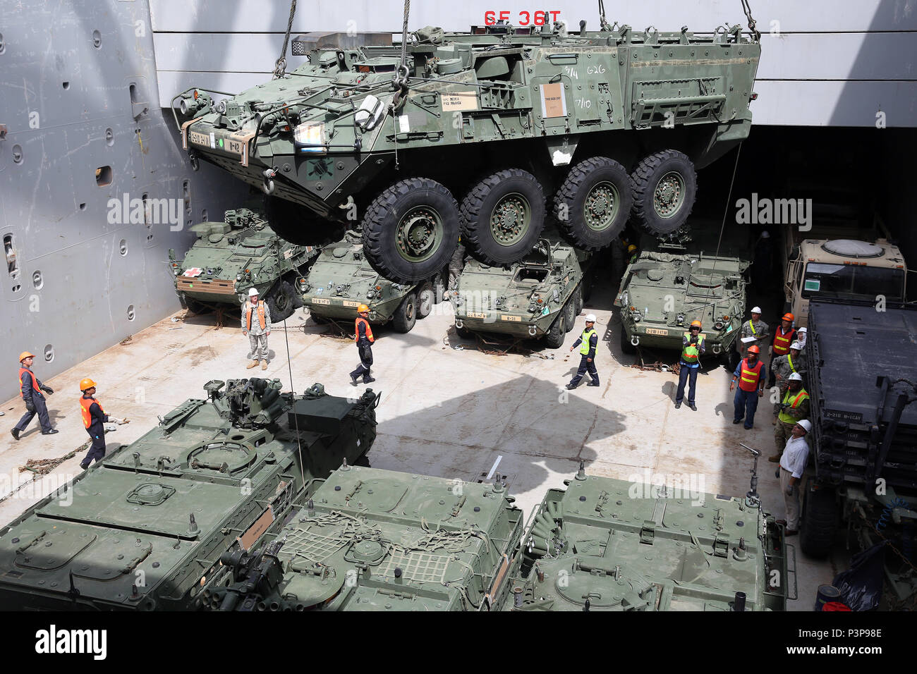 160712-N-IX266-012 SATTAHIP, Thailand—An M1126 Stryker is lowered into general purpose, heavy lift ship MV OCEAN GLORY during a backload of equipment at Chuk Samet, here, from exercise Hanuman Guardian, July 12. Military Sealift Command's contracted voyage-charter MV OCEAN GLORY recently conducted a backload of about 250 items in Thailand as part of U.S. Army Pacific's mobility operation PACIFIC PATHWAYS 16-2. (U.S. Navy photo by Grady T. Fontana/Released) - Stock Image