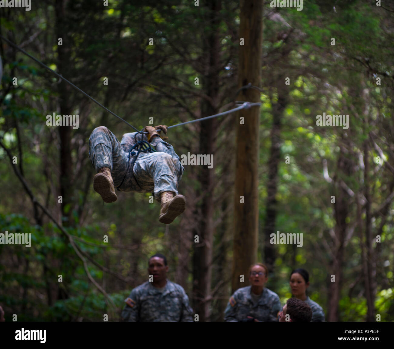 Cadets in Cadet Basic Training at Fort Knox, Ky , attempt to