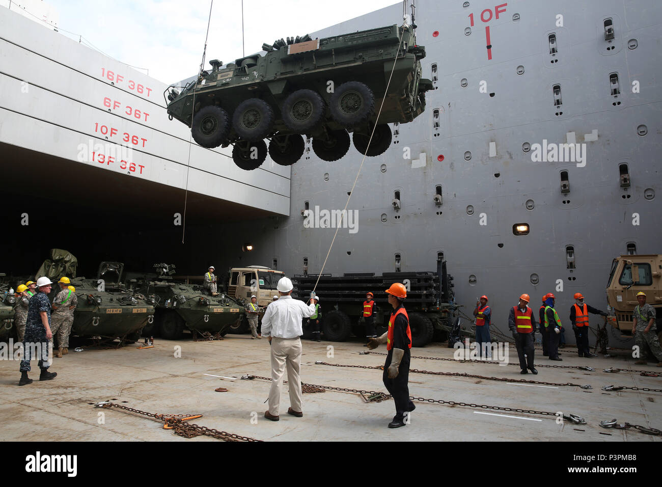160712-N-IX266-005 SATTAHIP, Thailand—An M1126 Stryker is lowered into general purpose, heavy lift ship MV OCEAN GLORY during a backload of equipment at Chuk Samet, here, from exercise Hanuman Guardian, July 12. Military Sealift Command's contracted voyage-charter MV OCEAN GLORY recently conducted a backload of about 250 items in Thailand as part of U.S. Army Pacific's mobility operation PACIFIC PATHWAYS 16-2. (U.S. Navy photo by Grady T. Fontana/Released) - Stock Image