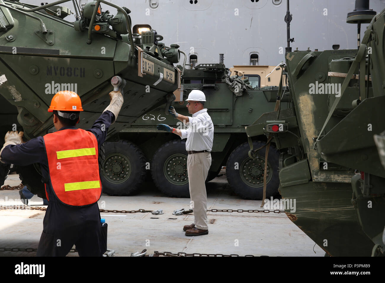 160712-N-IX266-008 SATTAHIP, Thailand—An M1126 Stryker is lowered into general purpose, heavy lift ship MV OCEAN GLORY during a backload of equipment at Chuk Samet, here, from exercise Hanuman Guardian, July 12. Military Sealift Command's contracted voyage-charter MV OCEAN GLORY recently conducted a backload of about 250 items in Thailand as part of U.S. Army Pacific's mobility operation PACIFIC PATHWAYS 16-2. (U.S. Navy photo by Grady T. Fontana/Released) - Stock Image
