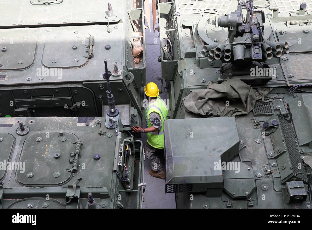 160712-N-IX266-011 SATTAHIP, Thailand—A soldier carefully guides in an M1126 Stryker in the cargo deck of general purpose, heavy lift ship MV OCEAN GLORY during a backload of equipment at Chuk Samet, here, from exercise Hanuman Guardian, July 12. Military Sealift Command's contracted voyage-charter MV OCEAN GLORY recently conducted a backload of about 250 items in Thailand as part of U.S. Army Pacific's mobility operation PACIFIC PATHWAYS 16-2. (U.S. Navy photo by Grady T. Fontana/Released) - Stock Image