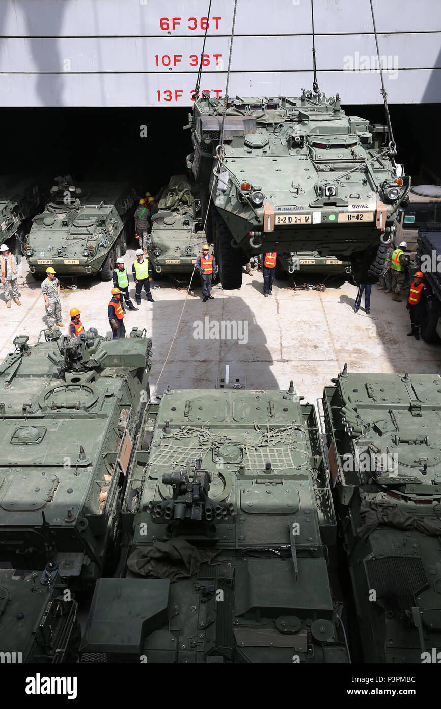 160712-N-IX266-013 SATTAHIP, Thailand—An M1126 Stryker is lowered into general purpose, heavy lift ship MV OCEAN GLORY during a backload of equipment at Chuk Samet, here, from exercise Hanuman Guardian, July 12. Military Sealift Command's contracted voyage-charter MV OCEAN GLORY recently conducted a backload of about 250 items in Thailand as part of U.S. Army Pacific's mobility operation PACIFIC PATHWAYS 16-2. (U.S. Navy photo by Grady T. Fontana/Released) - Stock Image
