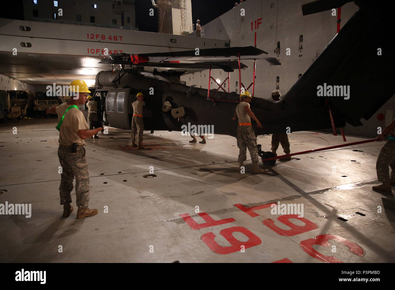 160712-N-IX266-017 SATTAHIP, Thailand—A UH-60 helicopter is positioned in the cargo deck of general purpose, heavy lift ship MV OCEAN GLORY during a backload of equipment at Chuk Samet, here, from exercise Hanuman Guardian, July 12. Military Sealift Command's contracted voyage-charter MV OCEAN GLORY recently conducted a backload of about 250 items in Thailand as part of U.S. Army Pacific's mobility operation PACIFIC PATHWAYS 16-2. (U.S. Navy photo by Grady T. Fontana/Released) - Stock Image