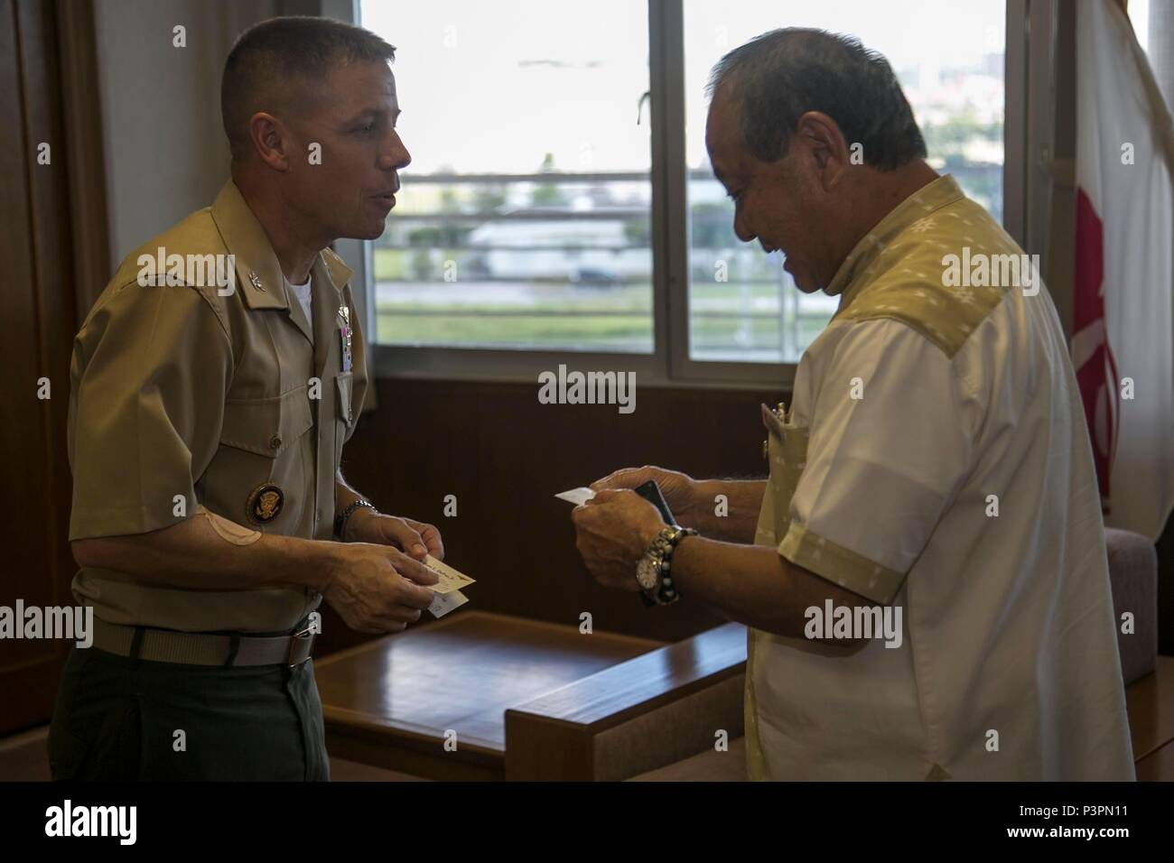 Col william l depue exchanges business cards with masaharu noguni william l depue exchanges business cards with masaharu noguni july 22 in chatan okinawa japan the exchange was part of a courtesy visit to noguni reheart Gallery