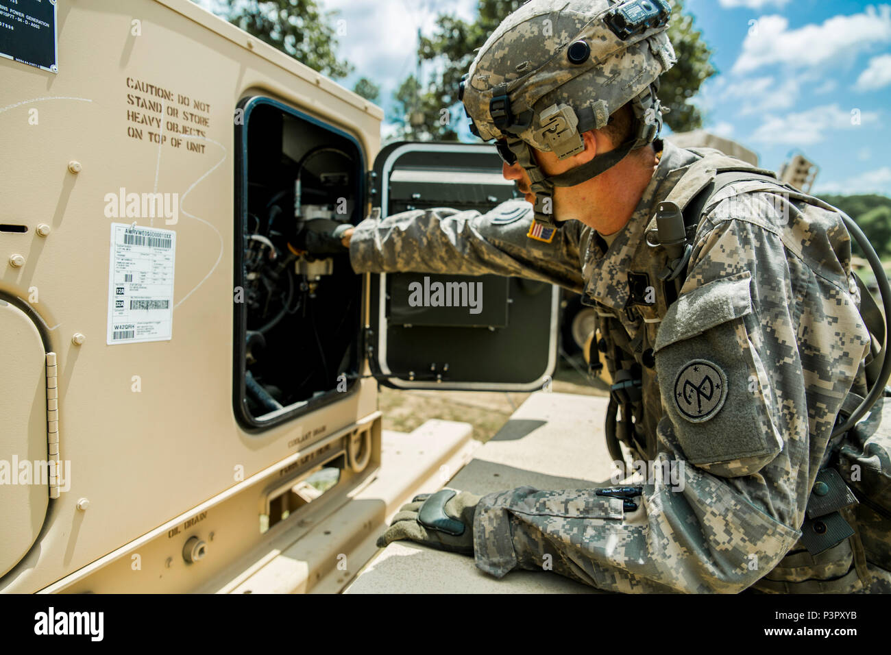 U.S. Army Sgt. Adam Lamb, a generator mechanic assigned to Echo Company, 427th Brigade Support Battalion, New York Army National Guard, works on a generator at the Joint Readiness Training Center, Ft. Polk, La., July 26, 2016. Approximately 3,000 Soldiers from New York joined 2,000 other state Army National Guard units, active Army and Army Reserve troops as part of the 27th Infantry Brigade Combat Team task force. The Soldiers are honing their skills and practicing integrating combat operations ranging from infantry troops engaging in close combat with an enemy to artillery and air strikes, J Stock Photo