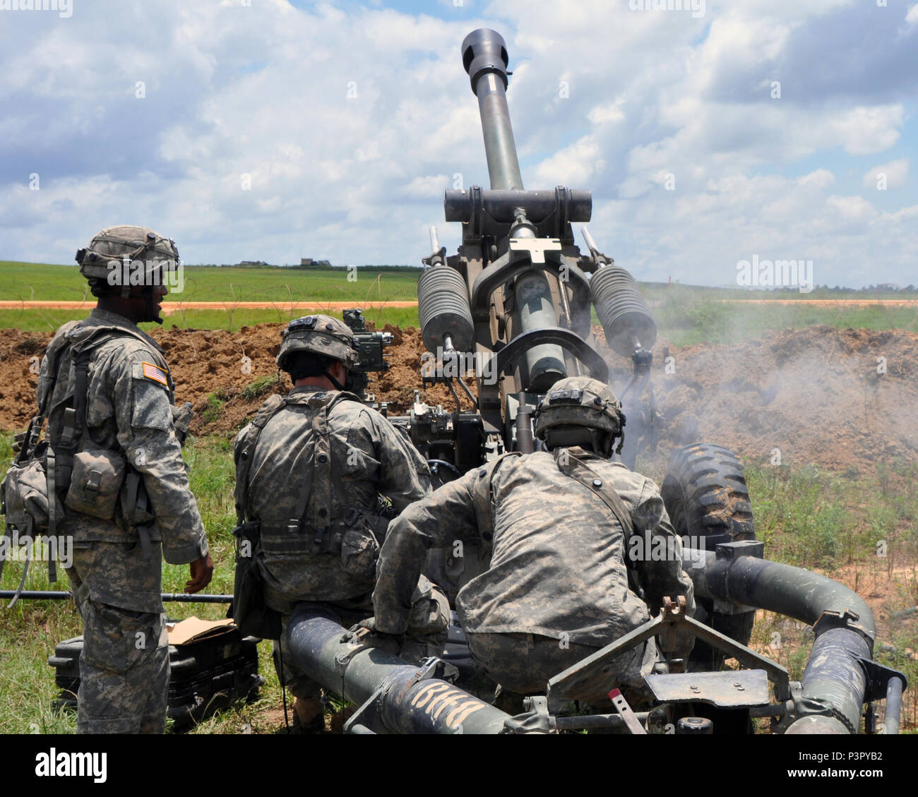 New York Army National Guard Soldiers assigned to Gun 8, Bravo Battery, 1st Battalion, 258th Field Artillery, based in Bronx, N.Y., fire their M119 Howitzer during training at the Joint Readiness Training Center, Ft. Polk, La., July 26, 2016. Approximately 3,000 Soldiers from New York joined 2,000 other state Army National Guard units, active Army and Army Reserve troops as part of the 27th Infantry Brigade Combat Team task force.  The Soldiers are honing their skills and practicing integrating combat operations ranging from infantry troops engaging in close combat with an enemy and employing  Stock Photo