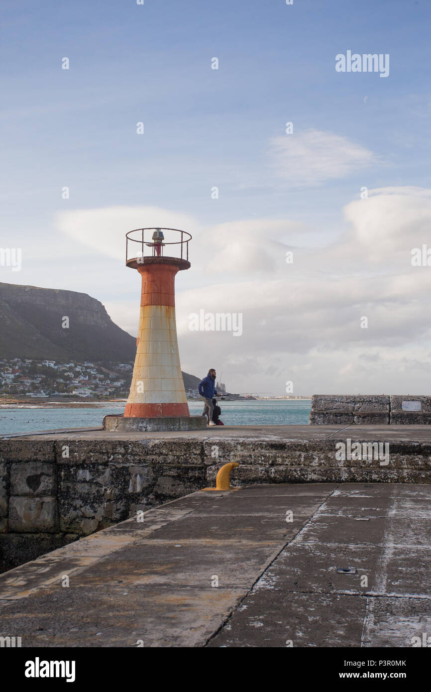 port light beacon navigational light, red and white, on harbour wall at Kalk Bay, False Bay, Cape Peninsula, South Africa concept guiding and safety - Stock Image