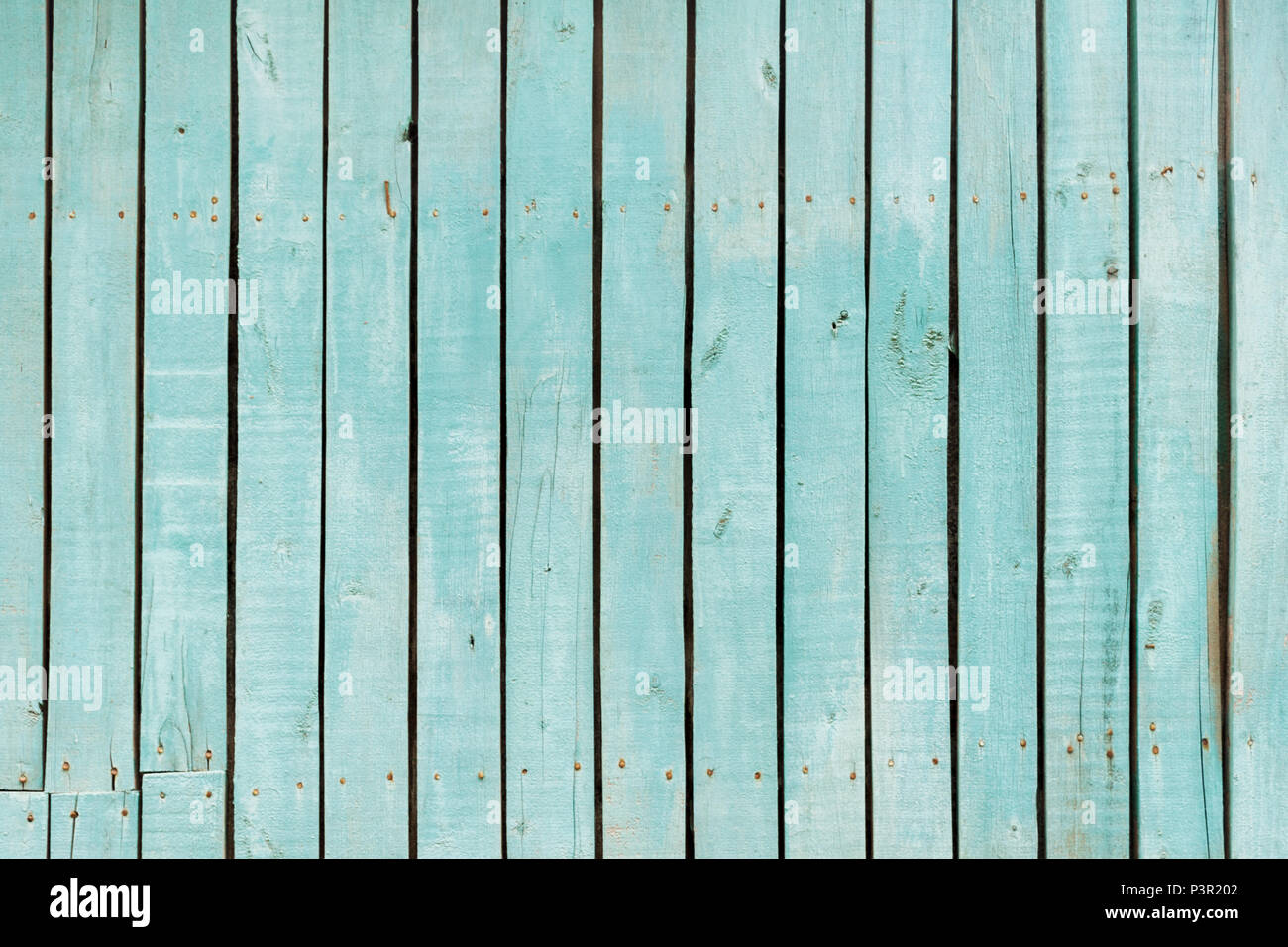 blue old wooden fence. wood palisade texture. planks background. - Stock Image