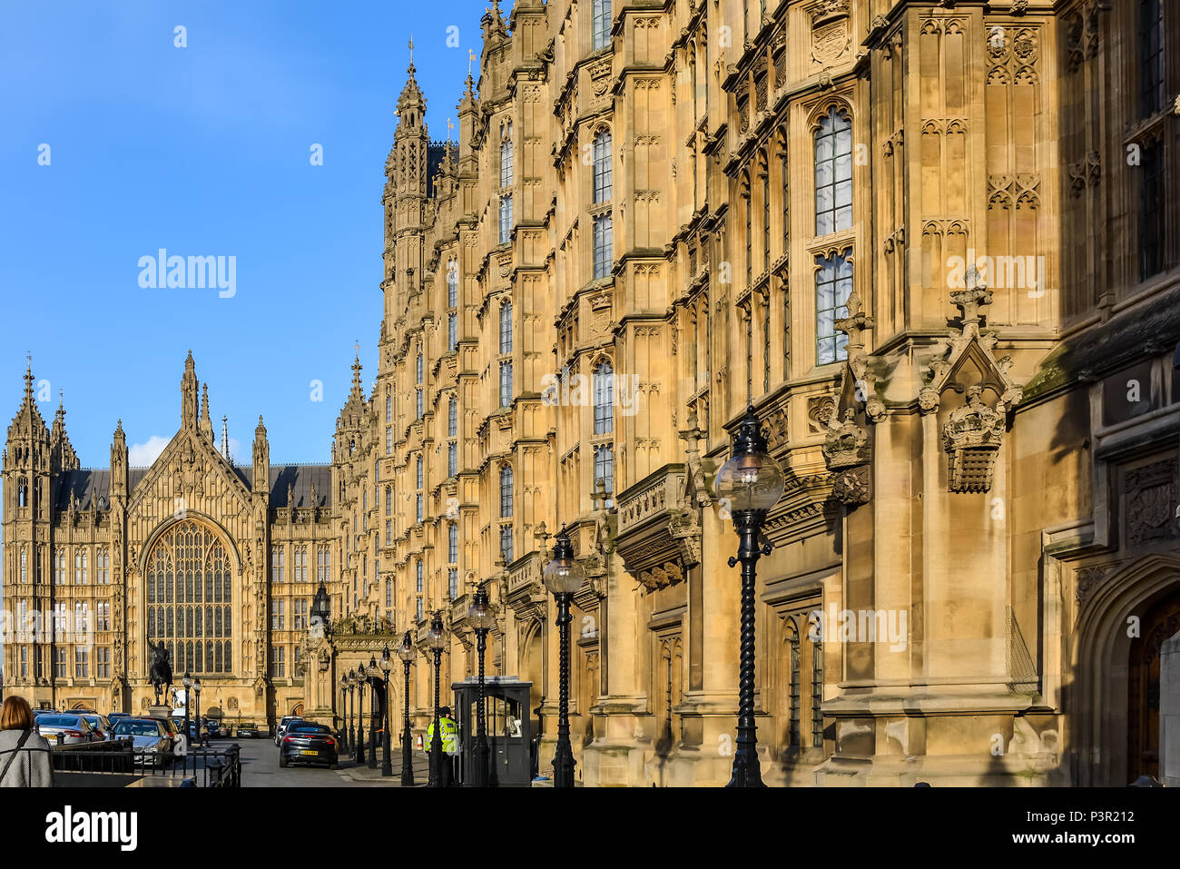 Old Palace Yard and the Victorian Gothic Palace of Westminster, with the statue of Richard Coeur de Lion in the middle and The Peers' Entrance on the  - Stock Image