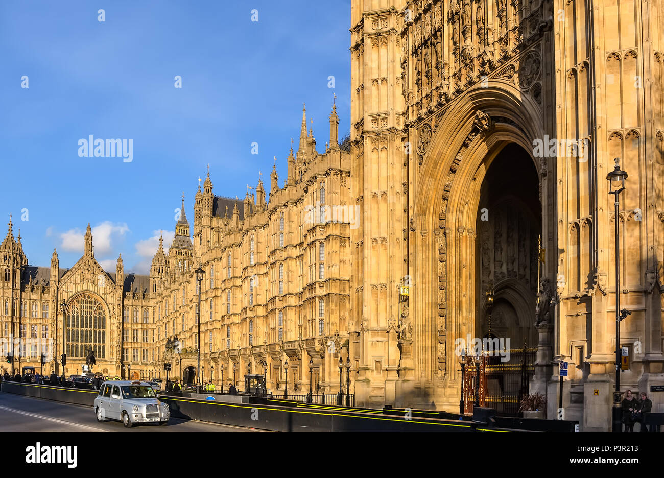 Old Palace Yard and the Gothic Revival style Palace of Westminster, with the statue of Richard Coeur de Lion, silver British cab and The Sovereign's E - Stock Image
