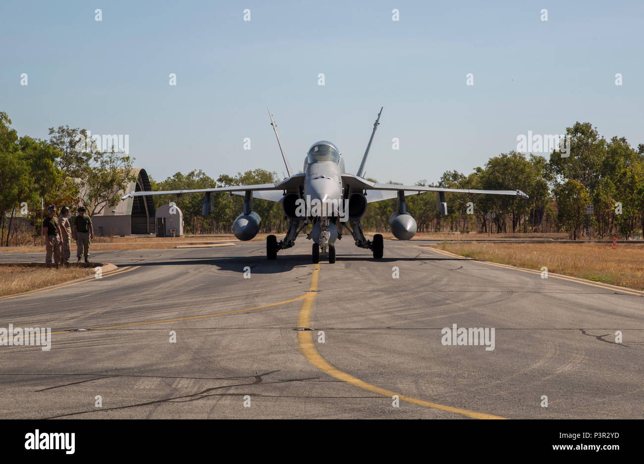 An F/A-18C Hornet with Marine Fighter Attack Squadron (VMFA) 122, forward deployed to Marine Corps Air Station Iwakuni, Japan, taxis into an ordnance loading area after landing at Royal Australian Air Force Base Tindal, Australia, July 21, 2016. VMFA-122 traveled to RAAF Base Tindal for the first time to participate in Pitch Black 2016 and unit level training known as Southern Frontier. Pitch Black affords Marines with VMFA-122 the opportunity to integrate and increase interoperability with regional joint and coalition partners, while developing operational concepts for conducting sustained co - Stock Image