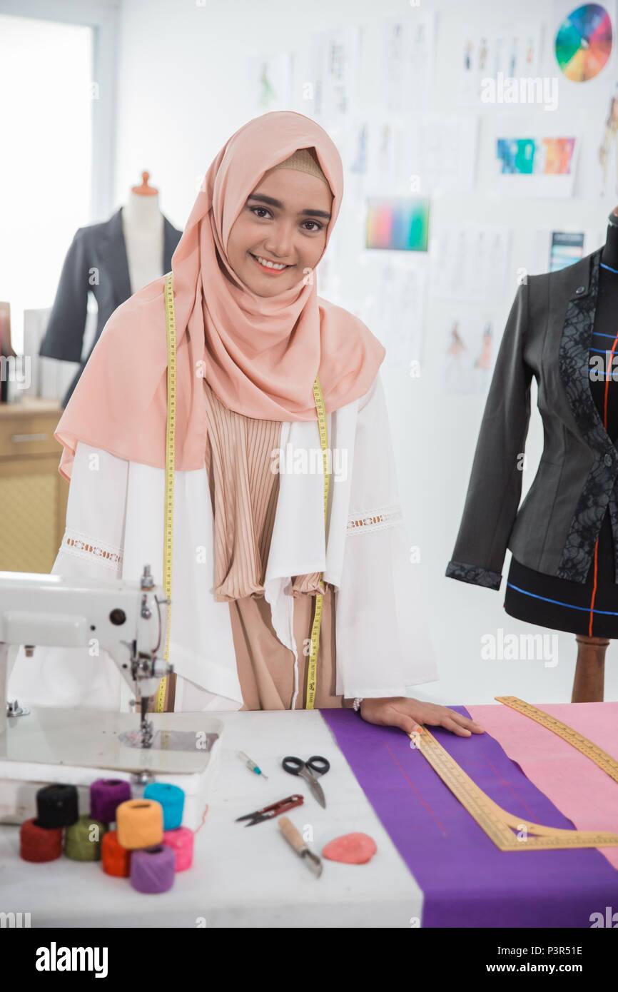 woman hijab tailor fashion designer Stock Photo - Alamy