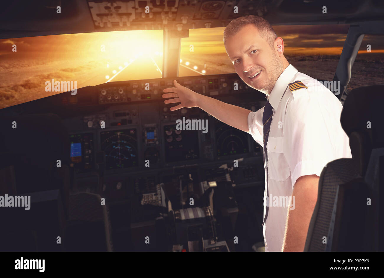 landing and smiling pilot of the plane - Stock Image