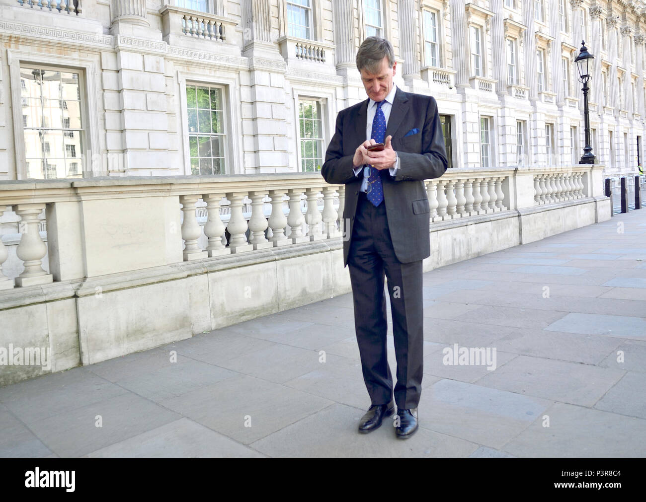 Dominic Grieve MP (Conservative: Beaconsfield) former Attourney General on his mobile phone in Whitehall Stock Photo