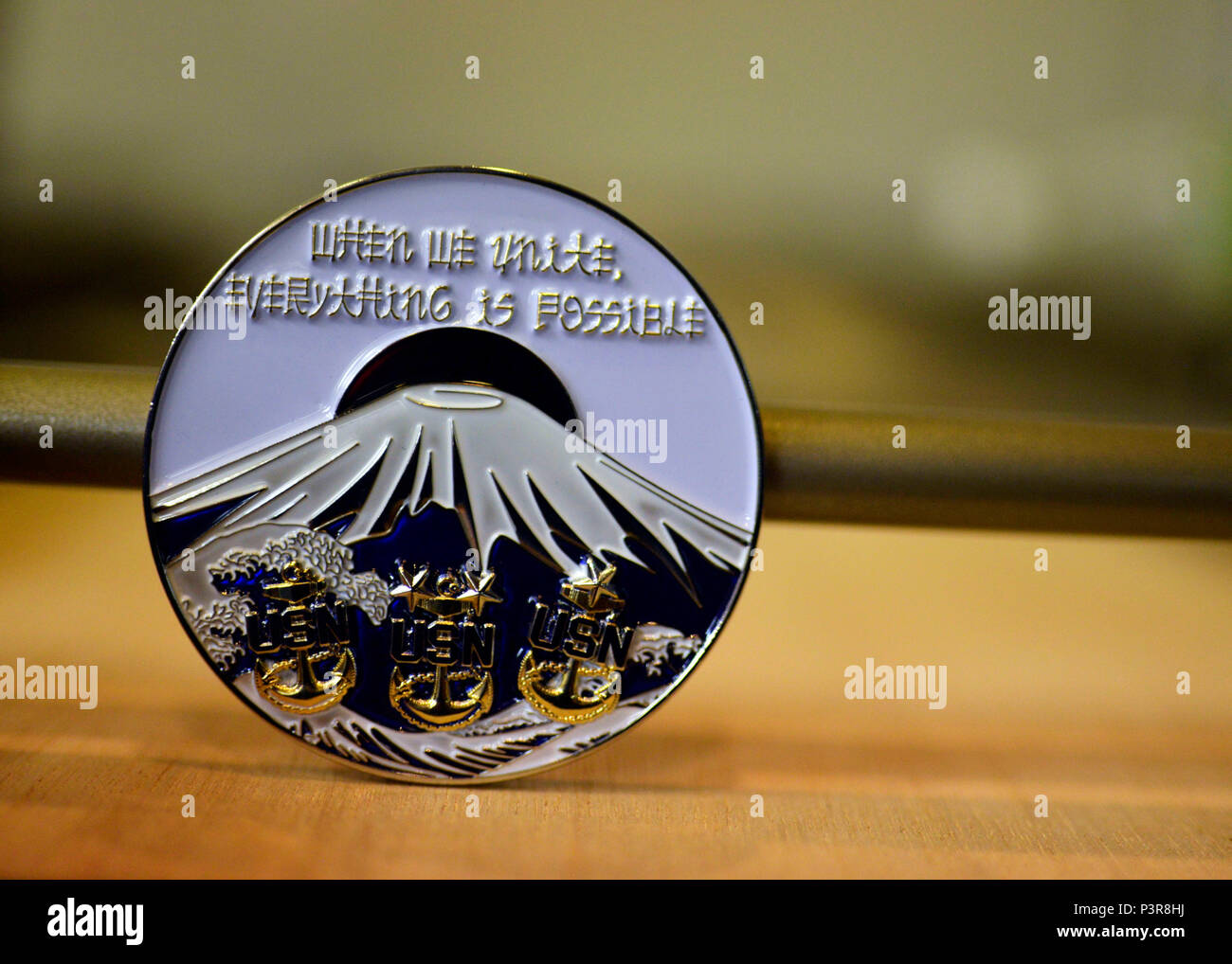 160726-N-OK605-145 KESENNUMA, Japan (July 27, 2016) One of the 100 specially made Navy challenge coins that Chief Master-at-Arms Brandon Johnson, attached to Afloat Training Group Yokosuka, had made and sold in order to raise a donation to give to the city of Kesennuma. Kesennuma is still rebuilding after it was struck by the 2011 tsunami. (U.S. Navy Photo by Mass Communication Specialist 2nd Class Samuel Weldin/Released) Stock Photo