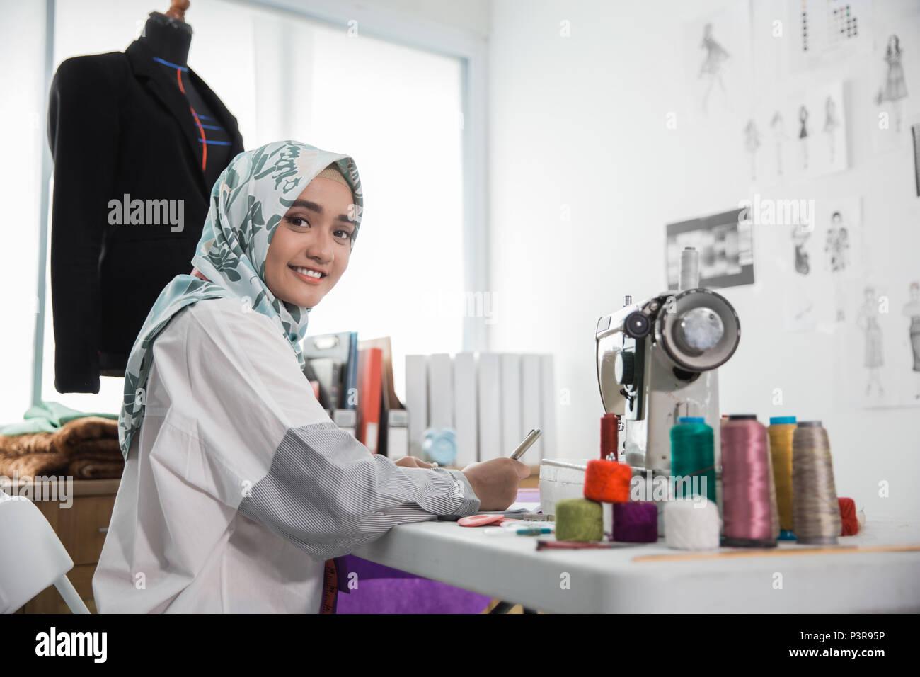 attractive muslim woman fashion designer - Stock Image