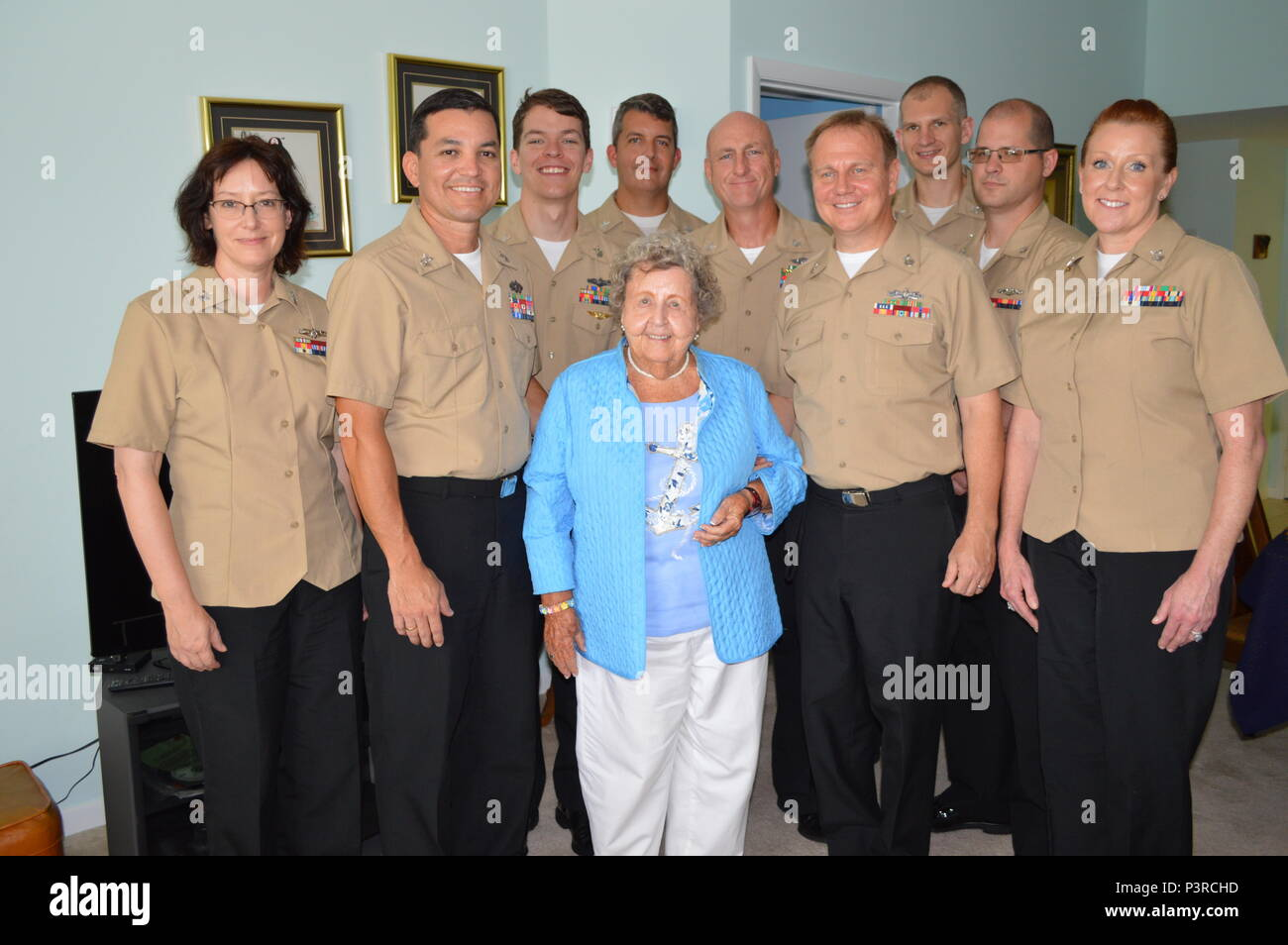 Mrs. Ima Black, the wife of the late Master Chief Petty Officer of the Navy (MCPON) Delbert Black, and the FY17 NOSC Orlando Chief Selects (L-R) ISC (SEL) Patricia Montgomery, EOC (SEL) Jhon Ballesteros, CTRC(sel) Drew Butikofer, ITC (SEL) Jeremy Worrells, MAC (SEL) Richard Carter, ETC (SEL) JeffreyTiner, OSC (SEL) Jonathan Scherach, ETRC (SEL) Matthew Rosenquist, and BMC (SEL) Angela Russell in Orlando, Fla., July 30, 2016.  (U.S. Navy photo by Chief Mass Communication Specialist Mark R. Richardson) - Stock Image