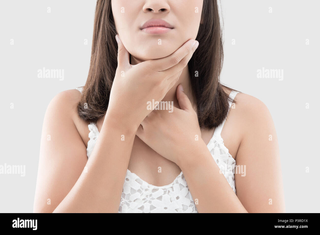 Closeup of asian woman hand touching her ill neck, Sore Throat, People suffering from throat pain, Medicine and health care concept. Stock Photo