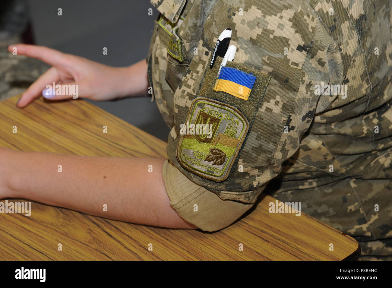 The Unit Patch Of The Armed Forces Of Ukraine On The Sleeve Of 1st Lt Bogdana Tverdokhlib Instructor Of The Ukrainian 169th Training Center Medical Sustainment Class Viper Pit 421st Medical Battalion