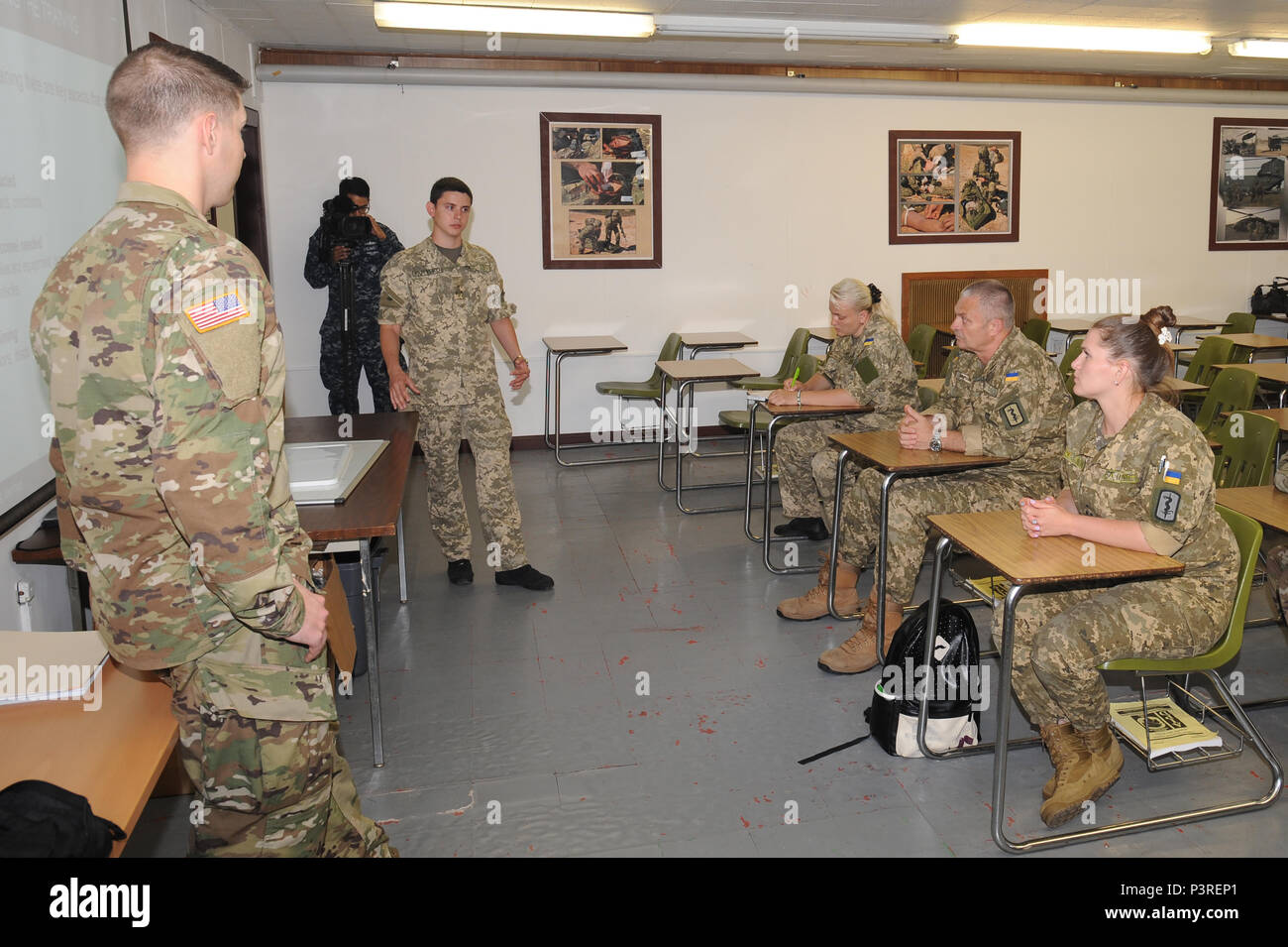 Sgt Troy R Wruk Left Health Care Specialist For Landstuhl Regional Medical Center Explains Unit Level Processes And Procedures Necessary For Medics To Operate In A Combat Situation To Ukraine Military Medical