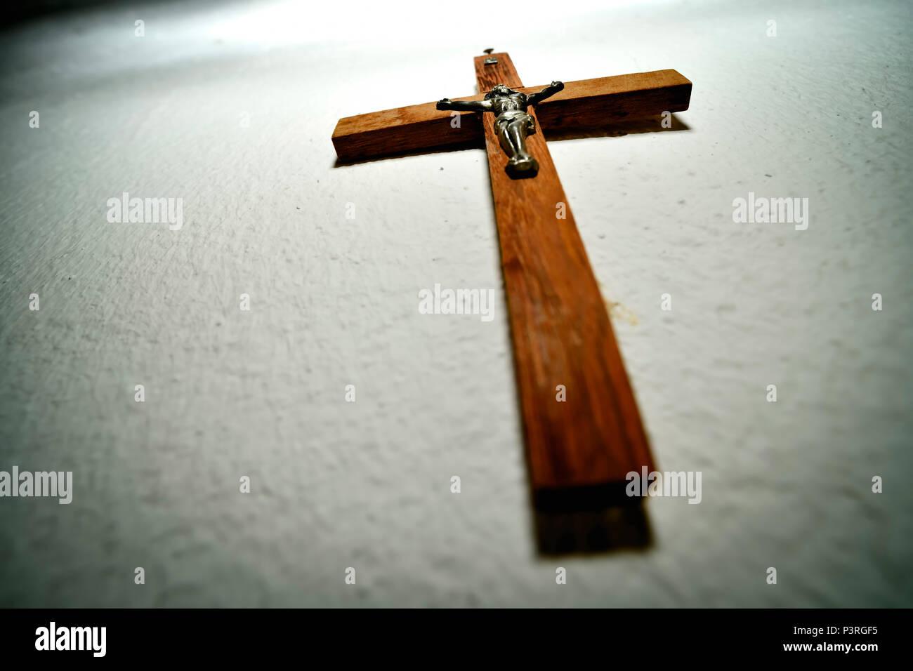 Cross hangs on the wall, Kreuz hängt an der Wand - Stock Image