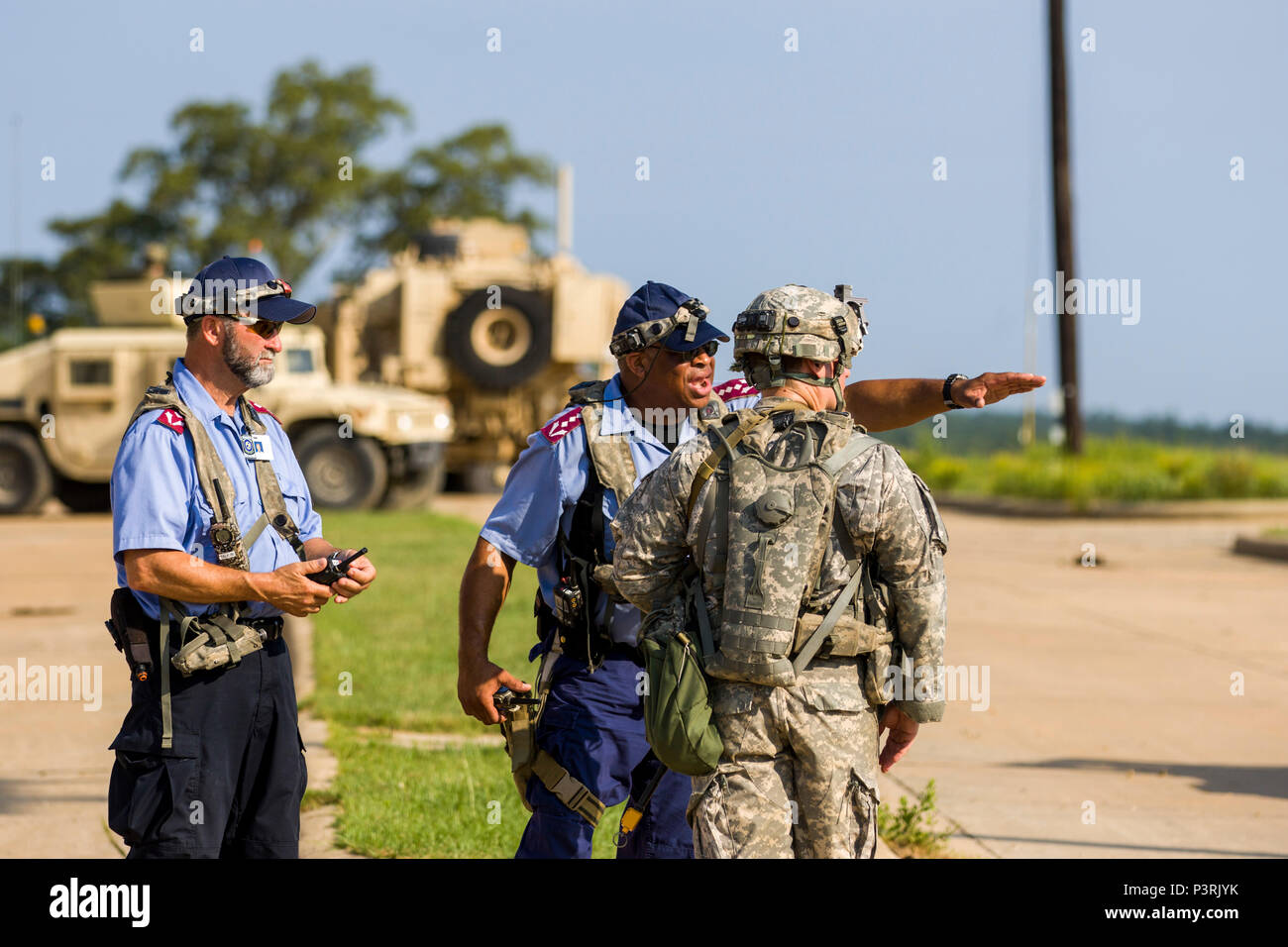 A Soldier with the 27th Infantry Brigade Combat Team speaks to police roleplayers in the fictional town of Dara Lam at the Joint Readiness Training Center, Ft. Polk, La., July 23, 2016.    Approximately 3,000 Soldiers from New York joined 2,000 other state Army National Guard units, active Army and Army Reserve troops as part of the 27th Infantry Brigade Combat Team task force.  The Soldiers are honing their skills and practicing integrating combat operations ranging from infantry troops engaging in close combat with an enemy to artillery and air strikes, July 9-30, 2016. (U.S. Army National G Stock Photo