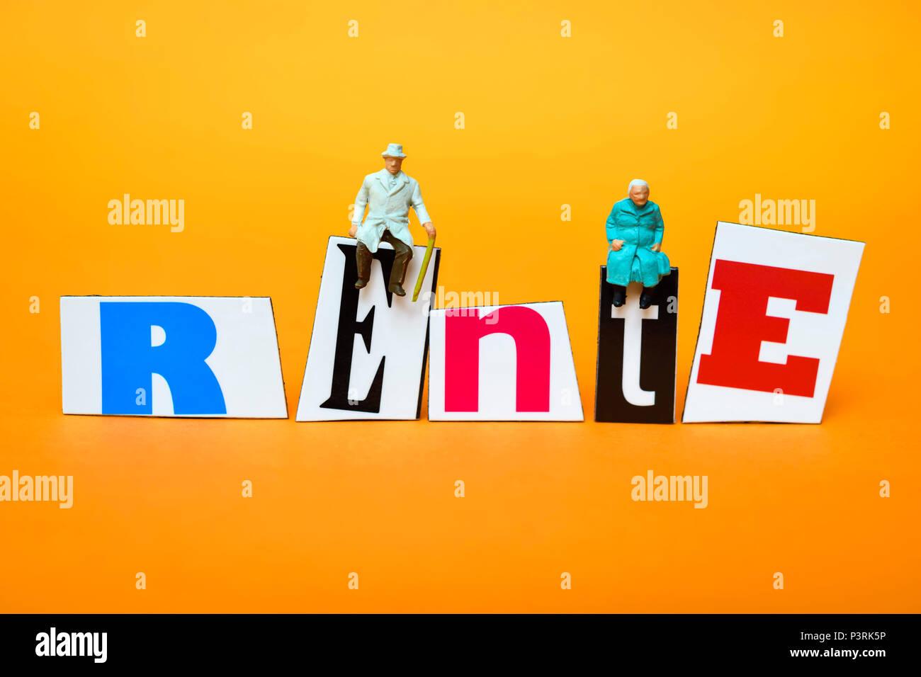 Miniature figures on the lettering Pension, Miniaturfiguren auf dem Schriftzug Rente Stock Photo