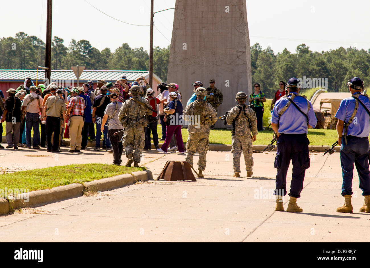 New York Army National Guard Soldiers assigned to 1st Battalion, 69th Infantry Regiment, along with Atropian police officers, observe a riot in the village of Dara Lam during training at the Army's Joint Readiness Training Center, Fort Polk, La.,  July 21, 2016. Approximately 3,000 Soldiers from New York joined 2,000 other state Army National Guard units, active Army and Army Reserve troops as part of the 27th Infantry Brigade Combat Team task force. The Soldiers are honing their skills and practicing integrating combat operations ranging from infantry troops engaging in close combat with an e Stock Photo
