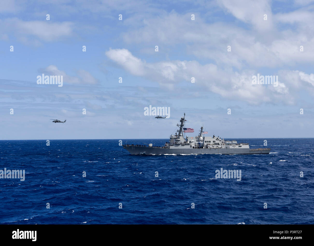 160728-N-KR702-144 PACIFIC OCEAN (June 28, 2016) – Two MH-60S Sea Hawk  helicopters fly over the Arleigh Burke-class guided-missile destroyer USS  Pinckney ...