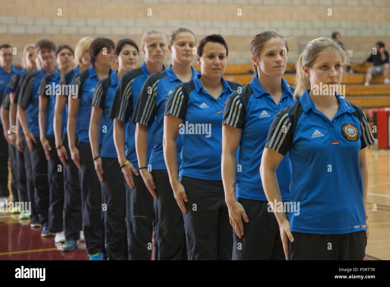 The team representing Germany in the World Military Women's Basketball Championship, stand at attention for the 2016 Conseil International Du Sport Militaire (CISM) closing ceremony on Camp Pendleton, Calif., July 29, 2016. The CISM championships are hosted around the world and provide an avenue for the United States to project the positive image with valuable military-to-military engagement through sports. (U.S. Marine Corps photo by Cpl. Tyler S. Dietrich) - Stock Image