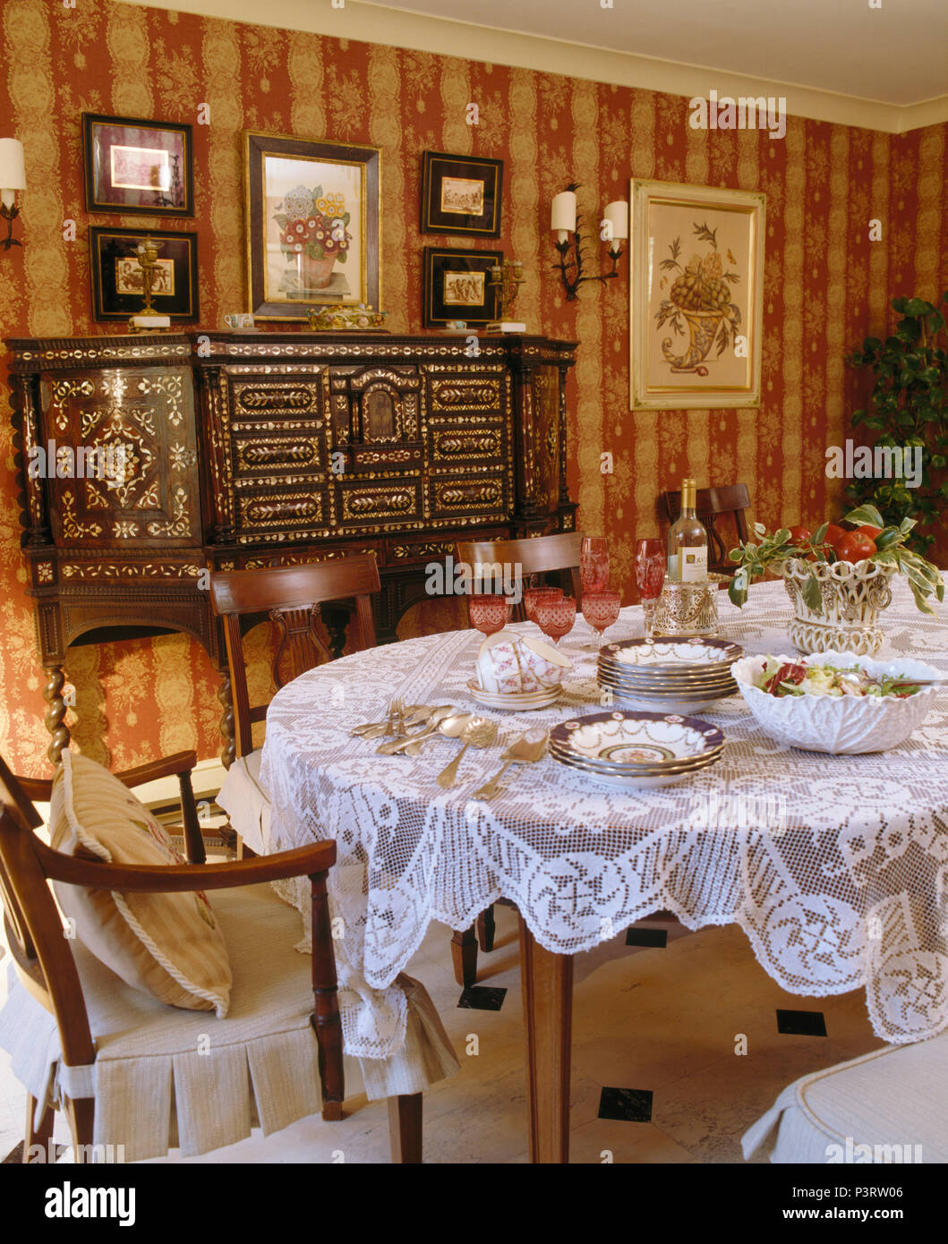 Lace Cloth On Table Set For Dinner In Elegant Dining Room With Red