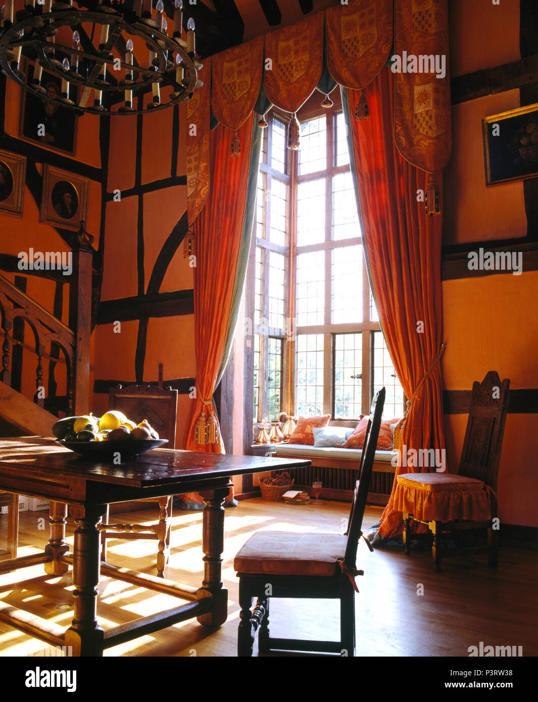 Orange Red Curtains At Tall Windows In Large Country House Dining Room With  Antique Furniture