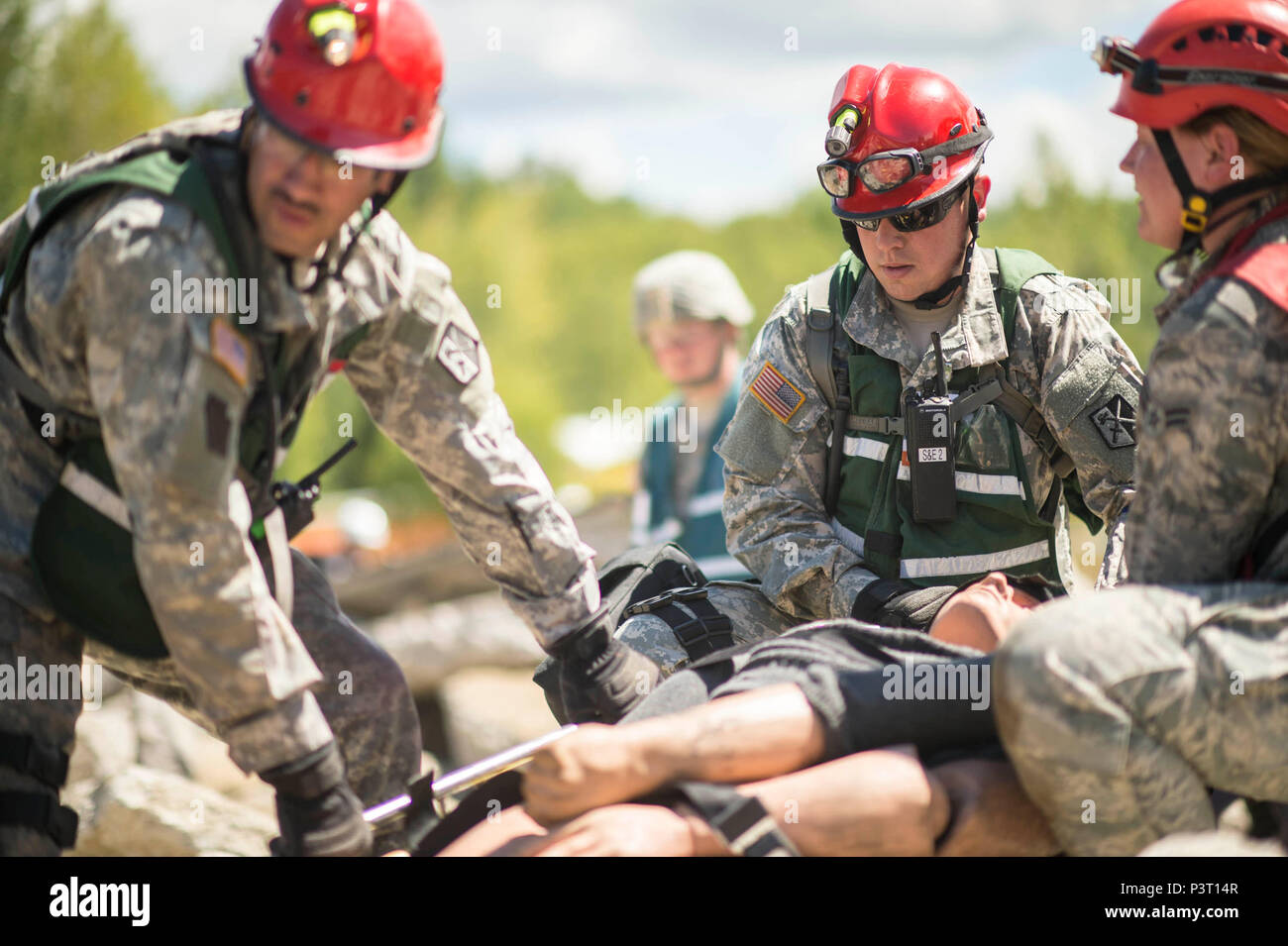 Multiple units from the Army and Air National guard work to clear through the rubble to rescue victims during a training scenario during Vigilant Guard 2016 at Camp Johnson, Colchester, Vt., July 30, 2016. Vigilant Guard is a national level emergency response exercise, sponsored by the National Guard and NORTHCOM, which provides National Guard units an opportunity to improve cooperation and relationships with regional civilian, military, and federal partners in preparation for emergencies and catastrophic events. (U.S. Air National Guard Photo by Senior Airman Jonathon Alderman) Stock Photo