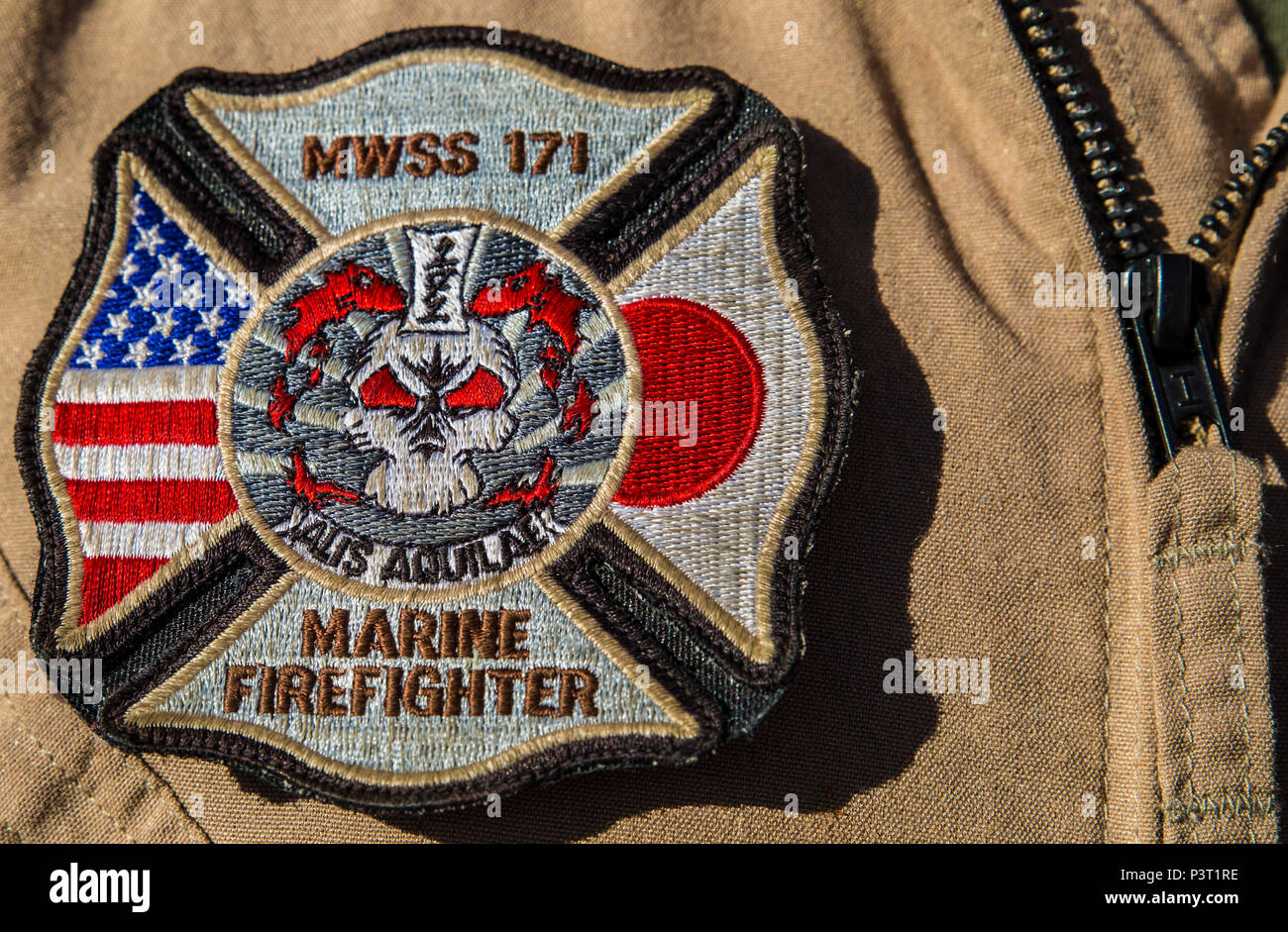 U.S. Marine Corps Cpl. Michael Barton, an aircraft rescue firefighter specialist with Marine Wing Support Squadron (MWSS) 171, sports an MWSS-171 Marine Firefighter patch during Exercise Pitch Black 2016 at Royal Australian Air Force Base Tindal, Australia, July 28, 2016. Barton is a liaison between Marine Fighter Attack Squadron (VMFA) 122 and No. 17 Squadron Fire and Rescue team stationed at RAAF Tindal, in case of emergencies with the flying squadron's aircraft during the exercise. Pitch Black is a multination exercise that also includes participation from Canada, France, Italy, Germany, In - Stock Image