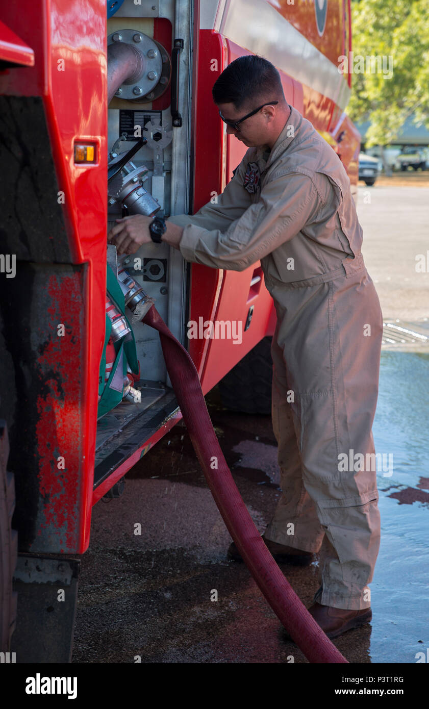 U.S. Marine Corps Cpl. Michael Barton, an aircraft rescue firefighter specialist with Marine Wing Support Squadron (MWSS) 171, refills a fire truck during Exercise Pitch Black 2016 at Royal Australian Air Force Base Tindal, Australia, July 28, 2016. Barton is a liaison between Marine Fighter Attack Squadron (VMFA) 122 and No. 17 Squadron Fire and Rescue team stationed at RAAF Tindal in case of emergencies with the flying squadron's aircraft during the exercise. Pitch Black is a multination exercise that includes participation from Canada, France, Italy, Germany, Indonesia, Netherlands, New Zea - Stock Image
