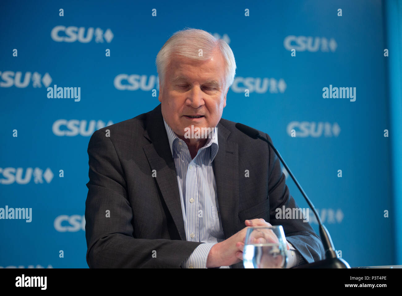 German minister of Interiour and CSU chairman Horst Seehofer speaks at the press conference. The Christian Social Union (CSU) held a board meeting, where they discussed about the argue with German Chancellor Angela Merkel and her Christian Democratic Union about the refugee crisis and the migration master plan (Masterplan Migration). (Photo by Alexander Pohl/ Pacific Press) - Stock Image