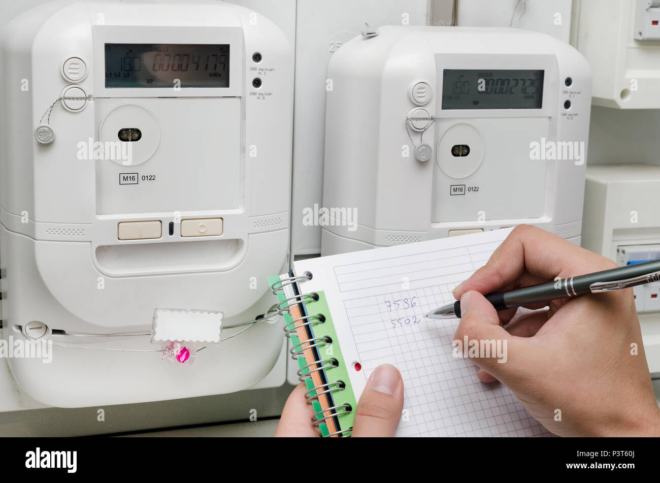Increasing Electricity Meter : Electric energy meter man notes the meter reading increase in