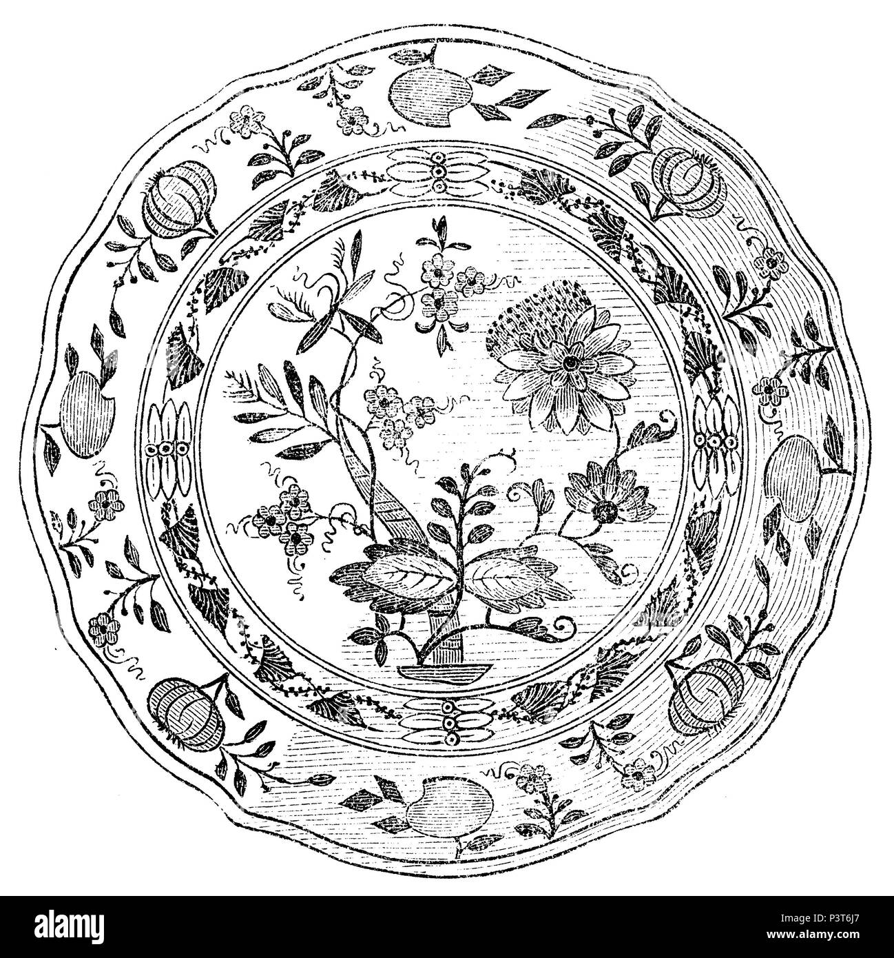 Plate with 'onion pattern'. Meissen Porcelain. The onion pattern, showing blue flowers and fruits, twigs and tendrils on a white background, is one of the most successful porcelain decors of all time. Developed according to Chinese models, it was already manufactured by the porcelain manufacturer Meissen in 1730 and since then has been adopted by many porcelain manufacturers.,   1872 - Stock Image