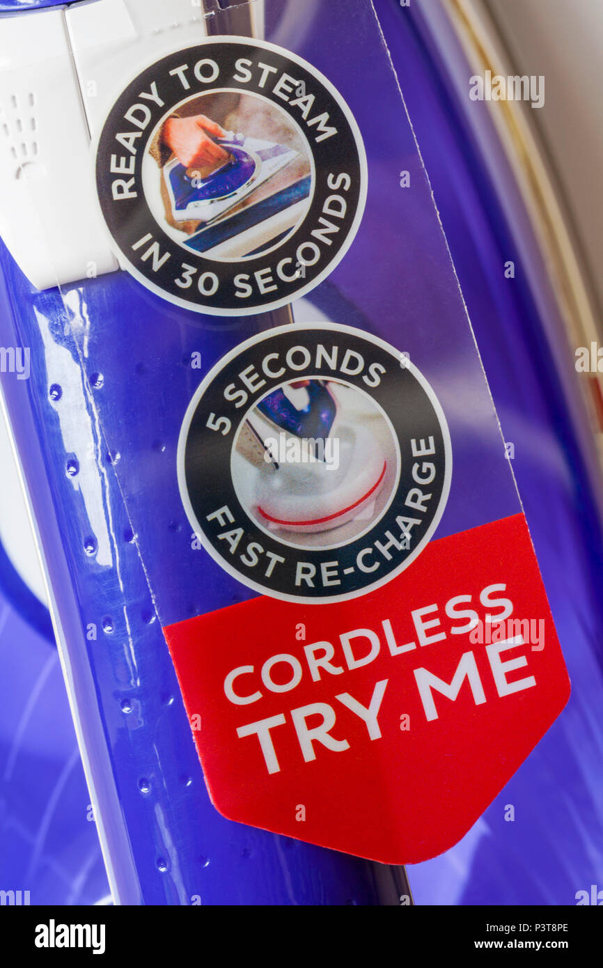 Cordless try me ready to steam in 30 seconds 5 seconds fast re-charge labels - Stock Image