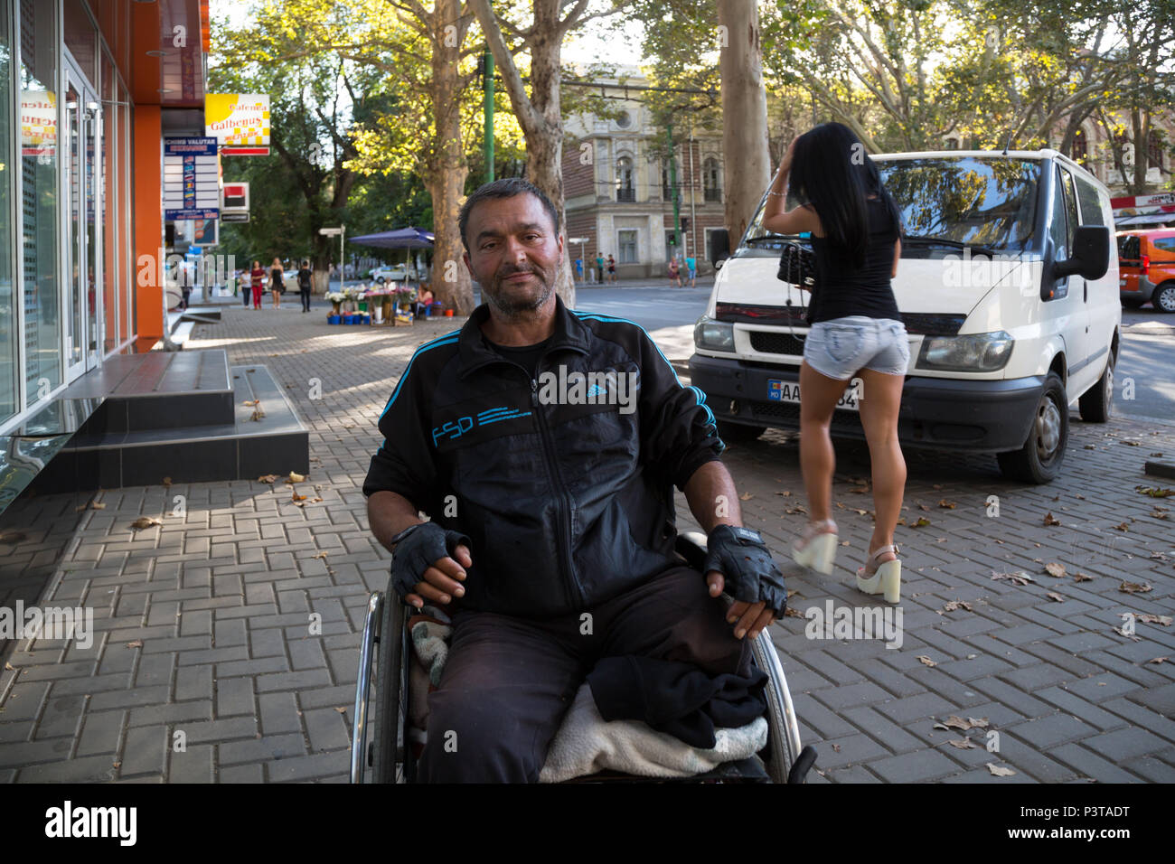 Moldova, Chisinau - Impoverished invalid in wheelchair - Stock Image