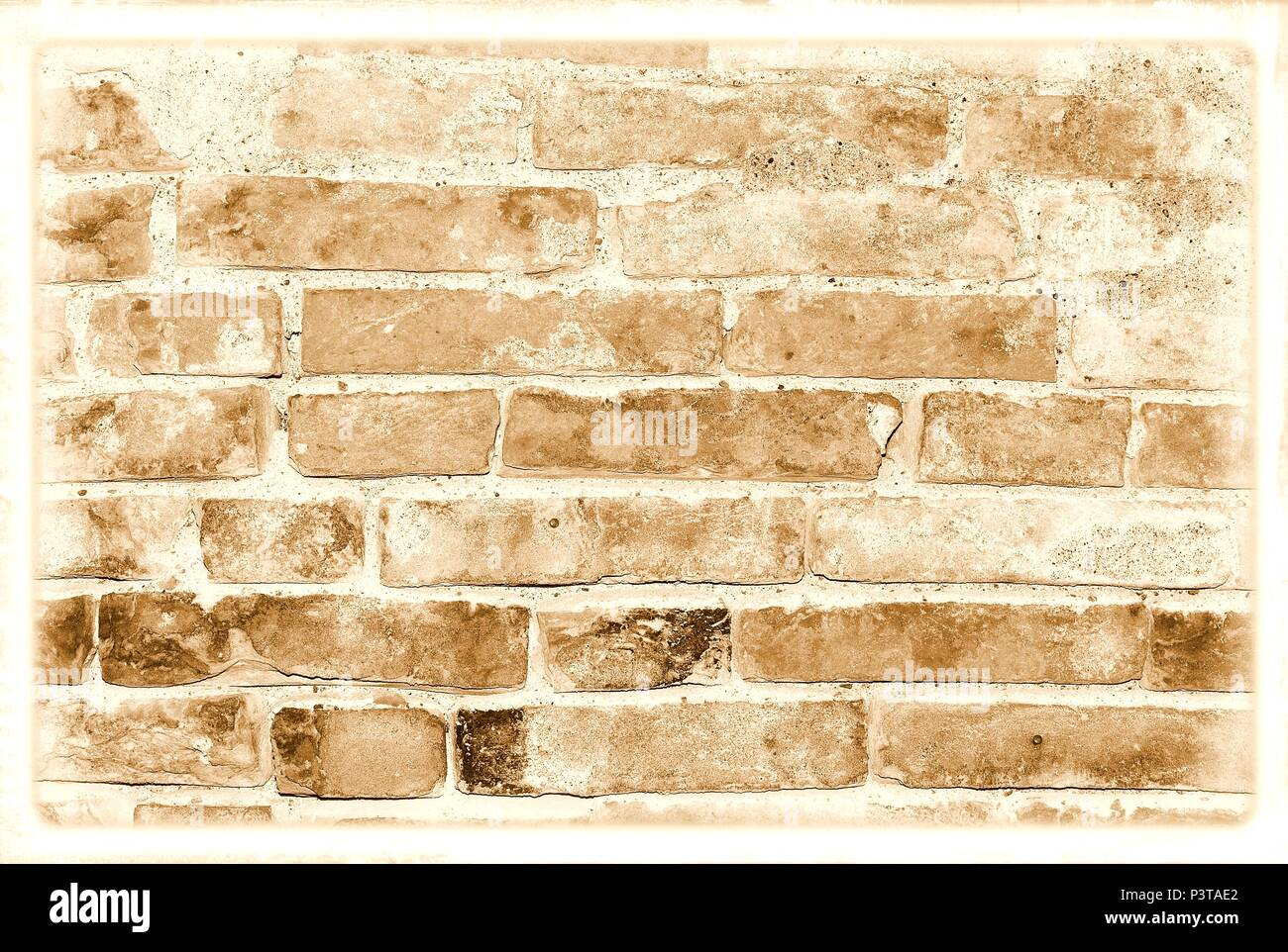 Old damaged brick wall in sepia tones for texture or background. Stock Photo