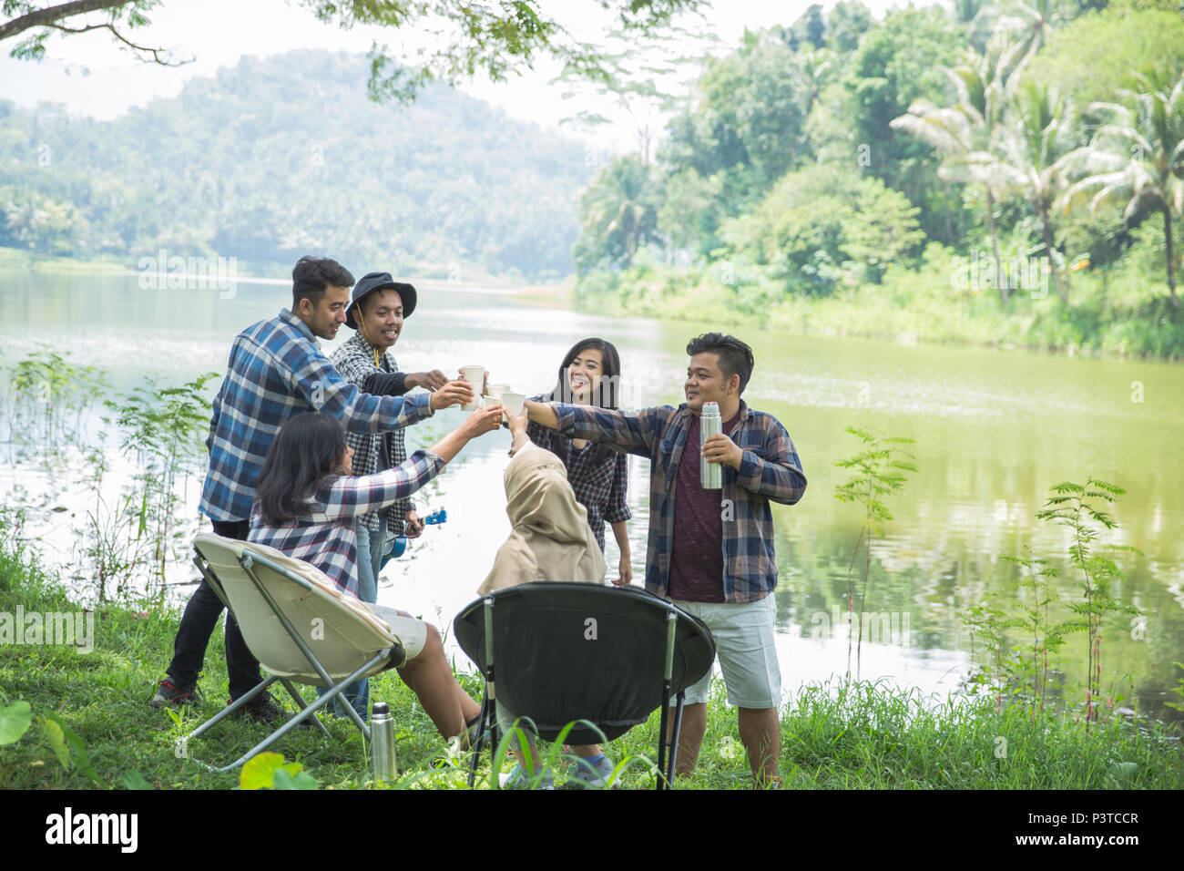 Friendship Hangout Traveling Destination. glass cheers - Stock Image