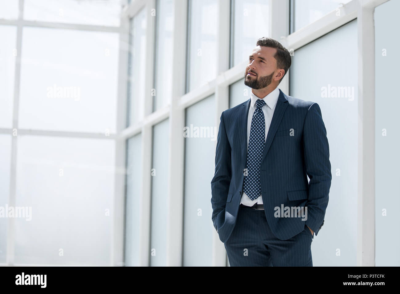 dreaming of a businessman standing in new office - Stock Image