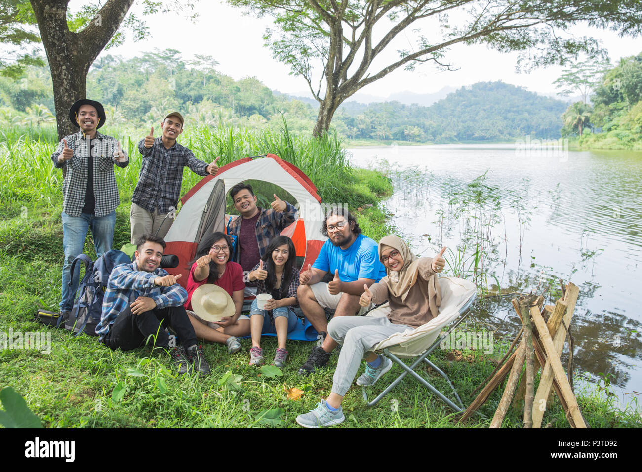people camping showing thumb up - Stock Image