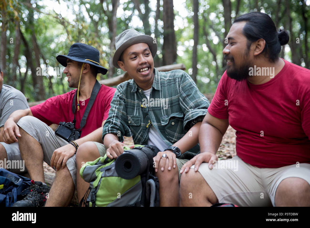 people hiker sitting and talking after hiking - Stock Image