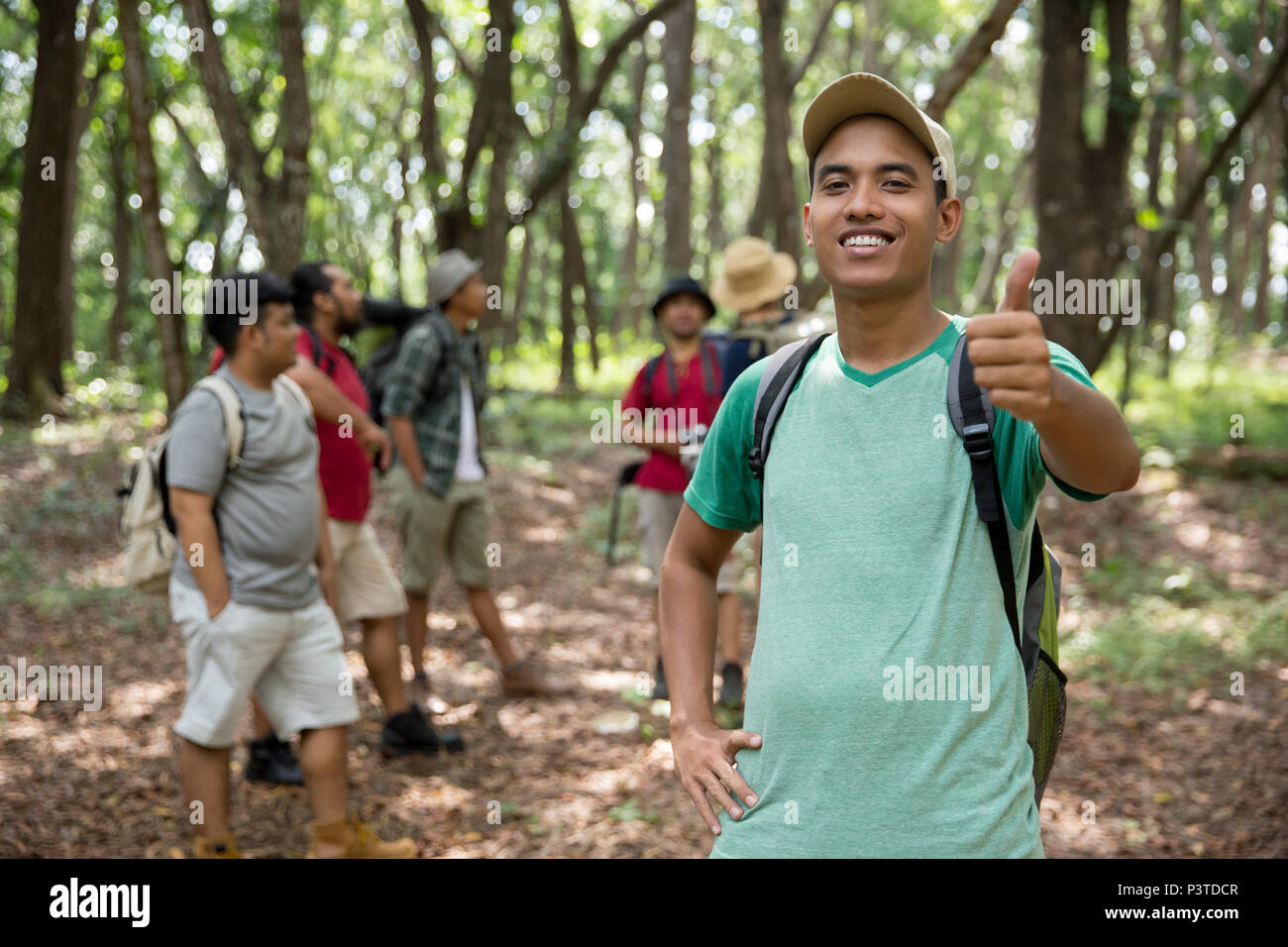 male hiker thumb up - Stock Image
