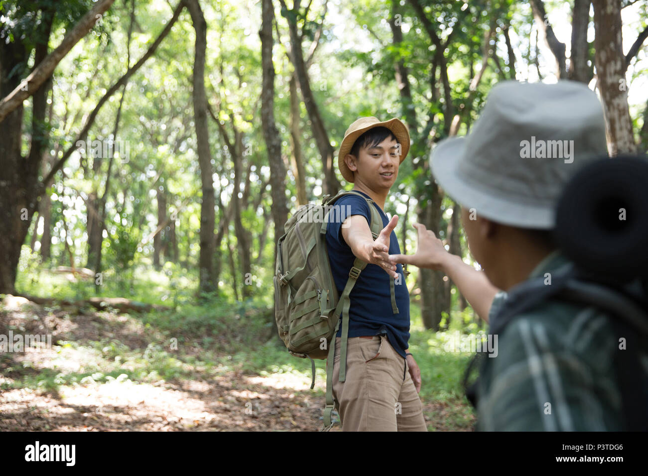 support friend to walk while hiking - Stock Image