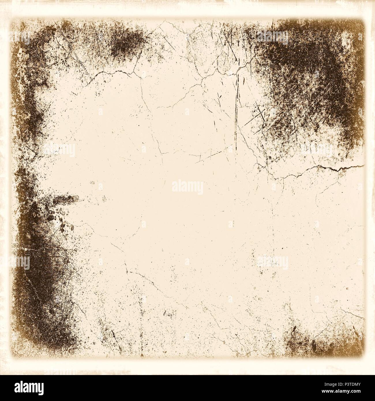 Vintage cracked wall in sepia tones with faded borders. - Stock Image
