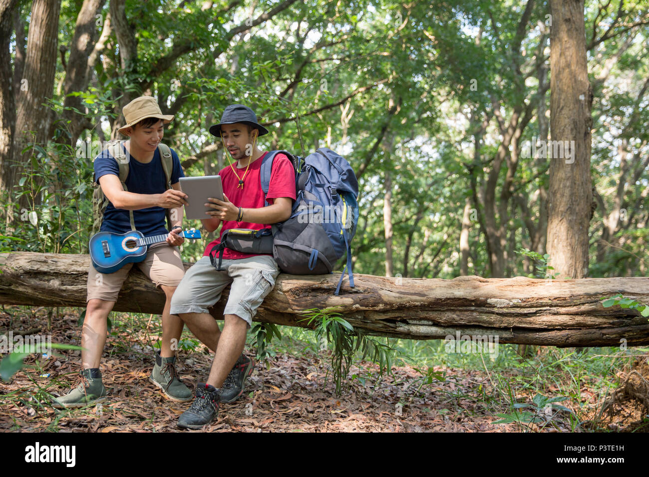 two male hiker using tablet pc - Stock Image